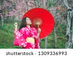 asia woman with kimono and red... | Shutterstock . vector #1309336993