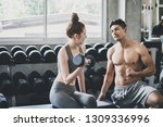 couple fitness man and asian... | Shutterstock . vector #1309336996