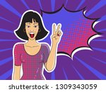 pop art smiling woman showing... | Shutterstock .eps vector #1309343059