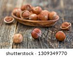 close up of hazelnuts on wooden ... | Shutterstock . vector #1309349770