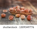 close up of hazelnuts on wooden ... | Shutterstock . vector #1309349776
