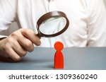 businessman examines a red man... | Shutterstock . vector #1309360240