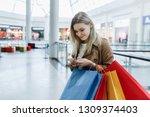 stylish fashion young woman... | Shutterstock . vector #1309374403