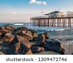 The Old Fishing Pier In Ocean...