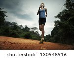 young lady running on cross... | Shutterstock . vector #130948916