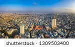 Top view aerial of Binh Tay market (or Cho Lon) and Ho Chi Minh city center with development buildings, transportation, energy power infrastructure. Financial and business centers in developed Vietnam