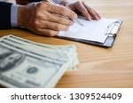 business man signing a contract.... | Shutterstock . vector #1309524409