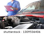 auto mechanic he notes the... | Shutterstock . vector #1309536406