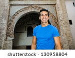 Portrait of an attractive smiling man in urban background - stock photo