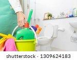 women carrying a cleaning... | Shutterstock . vector #1309624183
