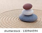 three pebbles stacked on a... | Shutterstock . vector #130964594