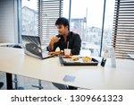 stylish indian man sitting at... | Shutterstock . vector #1309661323