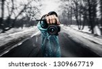 man holding a camera.... | Shutterstock . vector #1309667719