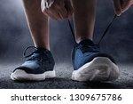 man tying running shoes | Shutterstock . vector #1309675786