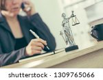 attorney woman talking on... | Shutterstock . vector #1309765066