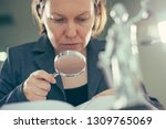 attorney woman using magnifying ... | Shutterstock . vector #1309765069