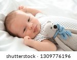 adorable newborn baby with toy... | Shutterstock . vector #1309776196