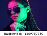 fashionable woman in sunglasses ... | Shutterstock . vector #1309787950