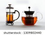 two isolated glass tea pots of... | Shutterstock . vector #1309802440