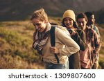 group of creatives on hiking... | Shutterstock . vector #1309807600