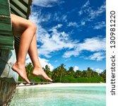 woman's legs at beach jetty | Shutterstock . vector #130981220