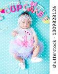 cut baby with pretty wear lying ...   Shutterstock . vector #1309828126