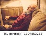 little nap. senior man sleeping ... | Shutterstock . vector #1309863283