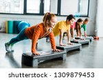 children doing plank exercise... | Shutterstock . vector #1309879453