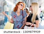beautiful women with shopping... | Shutterstock . vector #1309879939