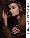 portrait of tender brunette... | Shutterstock . vector #1309943896