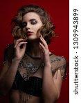 portrait of seductive brunette... | Shutterstock . vector #1309943899