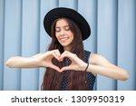 cool brunette woman in hat... | Shutterstock . vector #1309950319