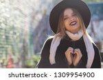 positive blonde woman wearing... | Shutterstock . vector #1309954900
