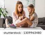 beautiful mother treating... | Shutterstock . vector #1309963480