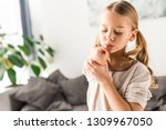upset kid blowing on wound at... | Shutterstock . vector #1309967050