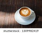 cup of espresso macchiato... | Shutterstock . vector #1309982419