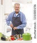 happy senior man making dinner... | Shutterstock . vector #131000156