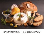 cheese and bread composition | Shutterstock . vector #1310003929