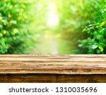 empty wooden table background | Shutterstock . vector #1310035696