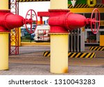 two yellow pipes with valves.... | Shutterstock . vector #1310043283