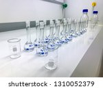 row of volumetric flask ... | Shutterstock . vector #1310052379