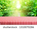 empty checkered table background | Shutterstock . vector #1310070286