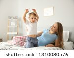 young pregnant woman playing... | Shutterstock . vector #1310080576