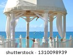 white wedding gazebo in a... | Shutterstock . vector #1310098939