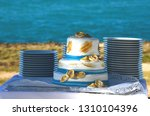 blue and gold wedding cake in... | Shutterstock . vector #1310104396
