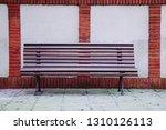 wooden bench in the street | Shutterstock . vector #1310126113