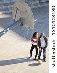 diverse teenagers college... | Shutterstock . vector #1310128180