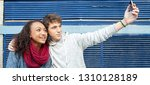 panoramic view of couple of... | Shutterstock . vector #1310128189