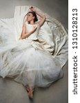 beautiful ballet dancer laying... | Shutterstock . vector #1310128213