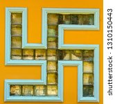 Small photo of Solar signs symbols of the swastika in a Buddhist temple ornament window with the swastika
